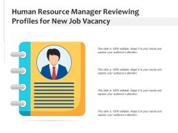 Human Resource Manager Reviewing Profiles For New Job Vacancy