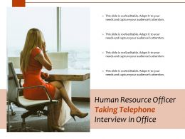 Human Resource Officer Taking Telephone Interview In Office