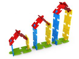 Huts Made From Puzzle Pieces Showing Concept Of Growth Stock Photo