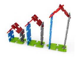 Huts Of Puzzle Pieces Represents Concept Of Growth Stock Photo