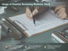 Image Of Chemist Reviewing Medicine Stock
