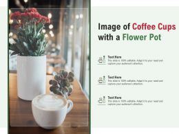 Image Of Coffee Cups With A Flower Pot