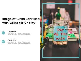 Image Of Glass Jar Filled With Coins For Charity