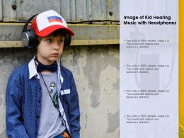 Image Of Kid Hearing Music With Headphones