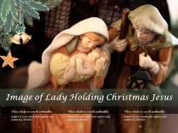 Image Of Lady Holding Christmas Jesus