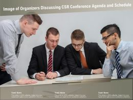 Image Of Organizers Discussing CSR Conference Agenda And Schedule