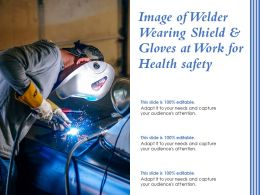 Image Of Welder Wearing Shield And Gloves At Work For Health Safety