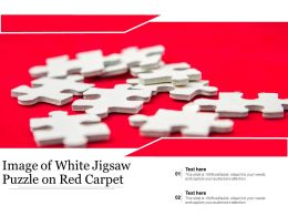 Image Of White Jigsaw Puzzle On Red Carpet