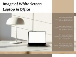 Image Of White Screen Laptop In Office