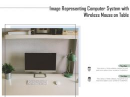 Image Representing Computer System With Wireless Mouse On Table