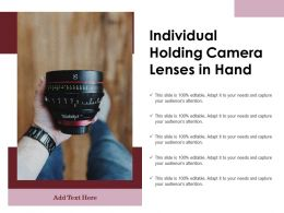 Individual Holding Camera Lenses In Hand