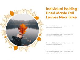 Individual Holding Dried Maple Fall Leaves Near Lake