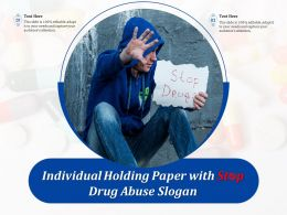 Individual Holding Paper With Stop Drug Abuse Slogan