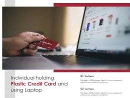 Individual Holding Plastic Credit Card And Using Laptop
