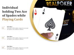 Individual Holding Two Ace Of Spades While Playing Cards