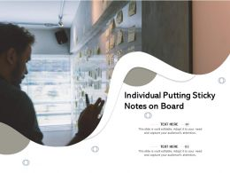 Individual Putting Sticky Notes On Board