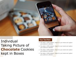Individual Taking Picture Of Chocolate Cookies Kept In Boxes