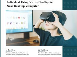Individual Using Virtual Reality Set Near Desktop Computer