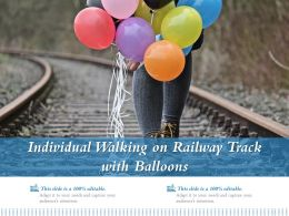 Individual Walking On Railway Track With Balloons