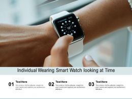 Individual Wearing Smart Watch Looking At Time