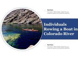 Individuals Rowing A Boat In Colorado River