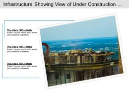 Infrastructure Showing View Of Under Construction Site With Workers And Tall Crane