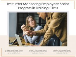 Instructor Monitoring Employees Sprint Progress In Training Class