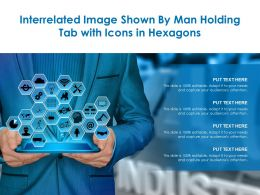 Interrelated Image Shown By Man Holding Tab With Icons In Hexagons
