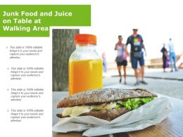 Junk Food And Juice On Table At Walking Area