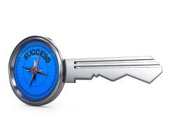 Key With Compass Head Pointing To Success Stock Photo