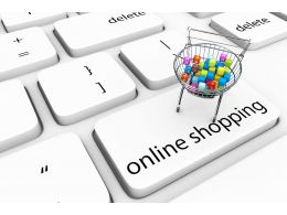 Keyboard Key Of Online Shopping With Cart Full Of Cubes Stock Photo