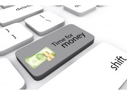 Keyboard Key With Text Of Time For Money Stock Photo