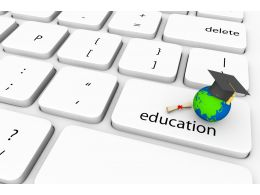 Keyboard With Key Of Education And Globe With Graduation Cap Stock Photo