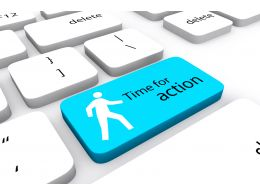 Keyboard With Time For Action Key Stock Photo