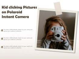 Kid Clicking Pictures On Polaroid Instant Camera