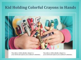 Kid Holding Colorful Crayons In Hands