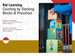 Kid Learning Counting By Stacking Blocks At Preschool
