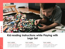 Kid Reading Instructions While Playing With Lego Set