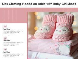 Kids Clothing Placed On Table With Baby Girl Shoes