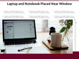 Laptop And Notebook Placed Near Window