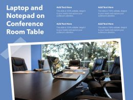 Laptop And Notepad On Conference Room Table
