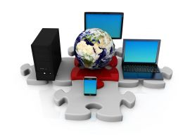 Laptop Computer With Globe And Server Graphic On Puzzle Stock Photo