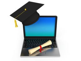 Laptop For learning And Graduation Cap With Degree Stock Photo