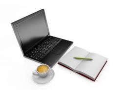 Laptop With Cup Of Coffee And Notebook Stock Photo