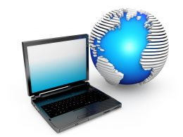 Laptop With Globe Displaying Technology Stock Photo