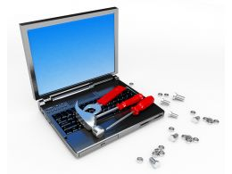Laptop With Hammer Screwdriver For Repair Work Stock Photo