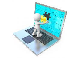 Laptop With Puzzle Screen And 3d Man Stock Photo