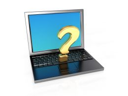 Laptop With Question Mark Stock Photo