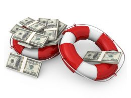 Life Saving Rings With Dollar Bundles On Top Stock Photo
