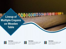 Lineup Of Multiple Crayons On Wooden Table